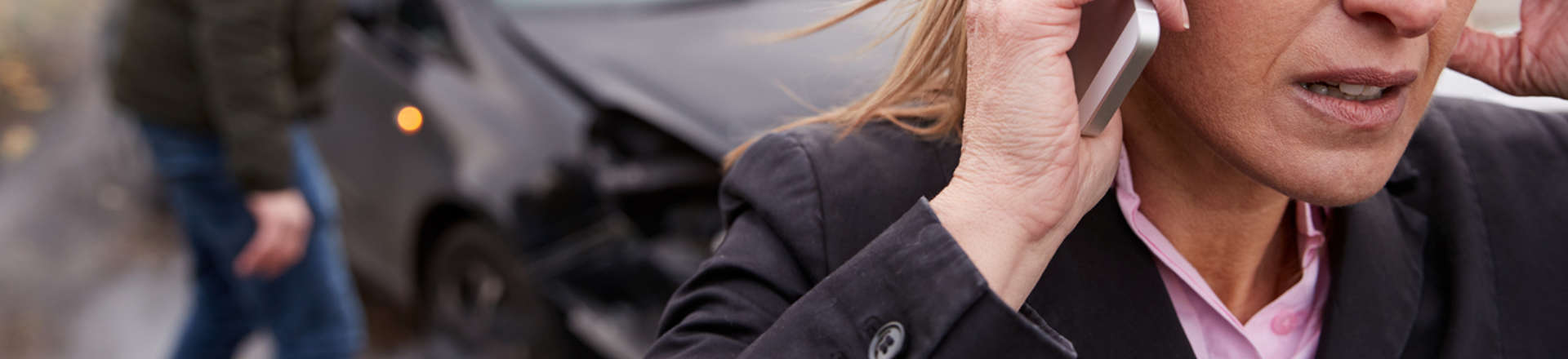 woman calling an attorney after a car accident